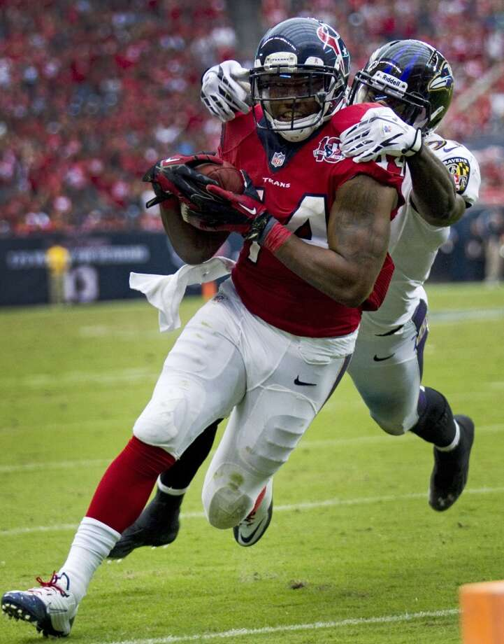 Texans running back Ben Tate (44) is caught from behind by Baltimore Ravens strong safety Bernard Pollard (31) during the fourth quarter. (Brett Coomer / Houston Chronicle)