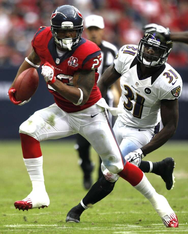 Texans running back Arian Foster (23) runs past Ravens strong safety Bernard Pollard (31) during the fourth quarter. (Brett Coomer / Houston Chronicle)