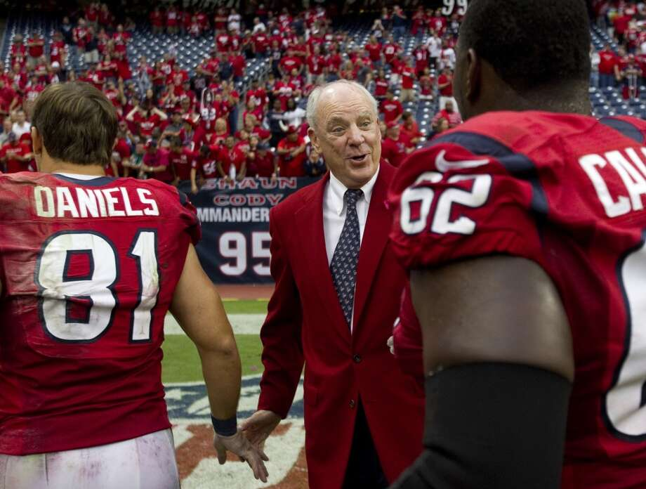 Texans owner Bob McNair greets tight end Owen Daniels (81) and guard Antoine Caldwell (62) after the Texans beat the Ravens. (Brett Coomer / Houston Chronicle)