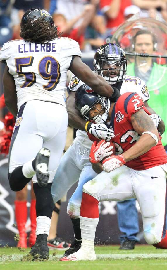 Texans running back Arian Foster (23) is tackled near the end zone by Ravens linebacker Dannell Ellerbe (59) and strong safety Bernard Pollard (31) during the fourth quarter. (Karen Warren / Houston Chronicle)
