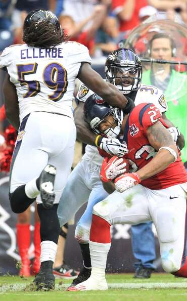 Texans running back Arian Foster (23) is tackled near the end zone by Ravens linebacker Dannell Elle