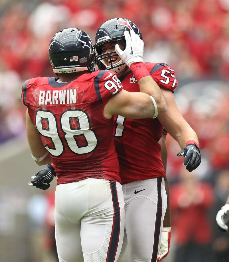 Texans outside linebacker Connor Barwin (98) celebrates his sack of Ravens quarterback Joe Flacco (5) for a safety with linebacker Jesse Nading (57) during the first quarter. (Nick de la Torre / Houston Chronicle)