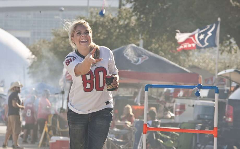 Lindsey Tolopka, of Houston, tailgates with friends before the Houston Texans game against the Baltimore Ravens. (Nick de la Torre / Houston Chronicle)
