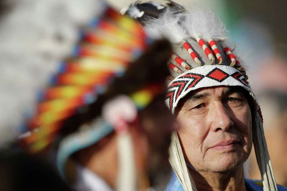 Native Indians wait for the start of a canonization ceremony celebrated by Pope Benedict XVI, in St. Peter's Square, at the Vatican, Sunday, Oct. 21, 2012. The pontiff will canonize seven people, Kateri Tekakwitha, the first Native American saint from the U.S., Maria del Carmen, Pedro Calungsod, Jacques Berthieu, Giovanni Battista Piamarta, Mother Marianne Cope, and Anna Shaeffer. Photo: Andrew Medichini, AP / AP