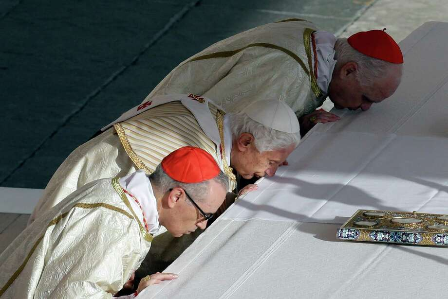 Pope Benedict XVI kisses the altar as he celebrates a canonization ceremony, in St. Peter's Square, at the Vatican, Sunday, Oct. 21, 2012. The pontiff will canonize seven people, Kateri Tekakwitha, Maria del Carmen, Pedro Calungsod, Jacques Berthieu, Giovanni Battista Piamarta, Mother Marianne Cope, and Anna Shaeffer. Photo: Alessandra Tarantino, AP / AP