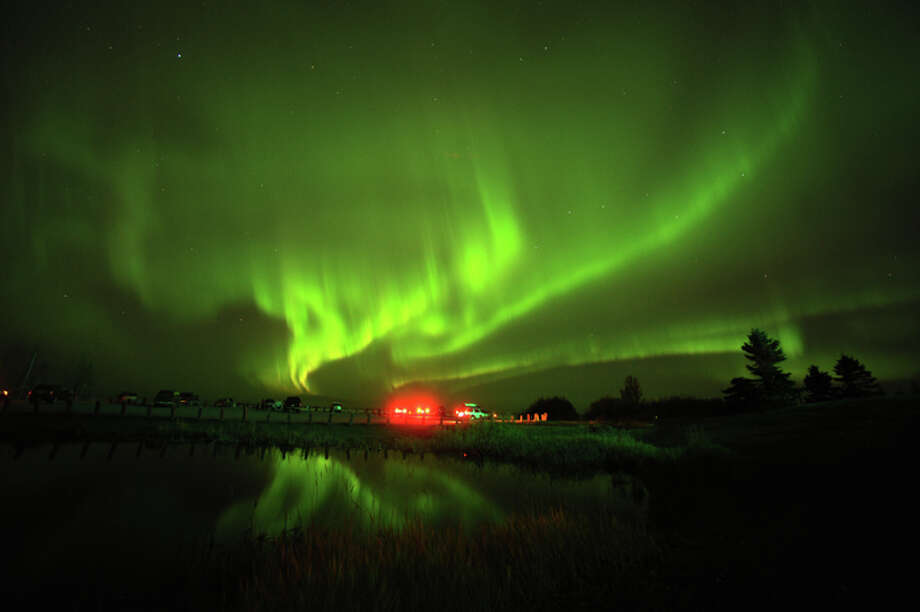 1: See the northern Lights Photo: Bob Hallinen, AP / Anchorage Daily News