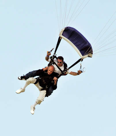 2: Skydive - Former U.S. Sen. George McGovern who recently died jumps from 18,000 feet, tandemed with Senior Jump Master Cristofer Parente at Skydive Space Center in Titusville. Fla. on Monday, July 19, 2020.  McGovern was making this jump in honor of his 88th birthday today and was inspired in part by his friend and former president George H.W. Bush. Bush skydived on his 75th, 80th and 85th birthdays. Photo: Michael R. Brown, AP / Associated Press
