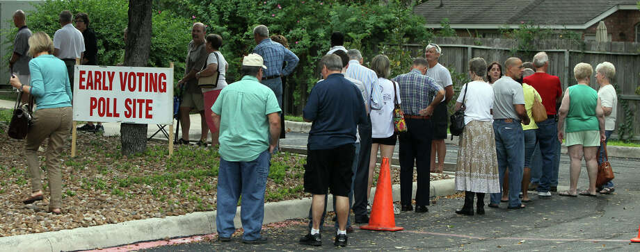 People line up for early voting Monday at the Brook Hollow Branch Library on the North Side. The 30,087 votes cast Monday outpaced the 29,119 votes recorded on the opening day in 2008. Photo: JOHN DAVENPORT, San Antonio Express-News / ©San Antonio Express-News/Photo Can Be Sold to the Public
