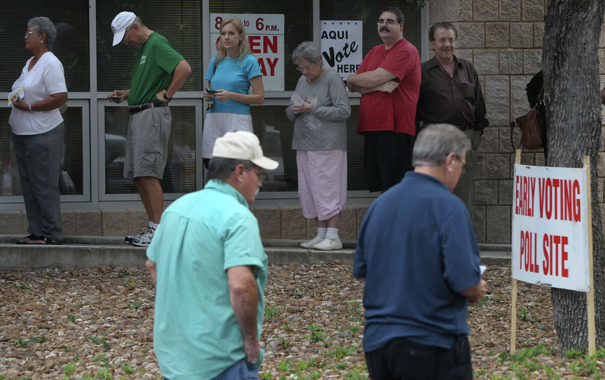 People line up for early voting Monday October 22, 2012 at the Brook Hollow Public Library on Heimer road. Early voting ends November 2 and election day is November 6.