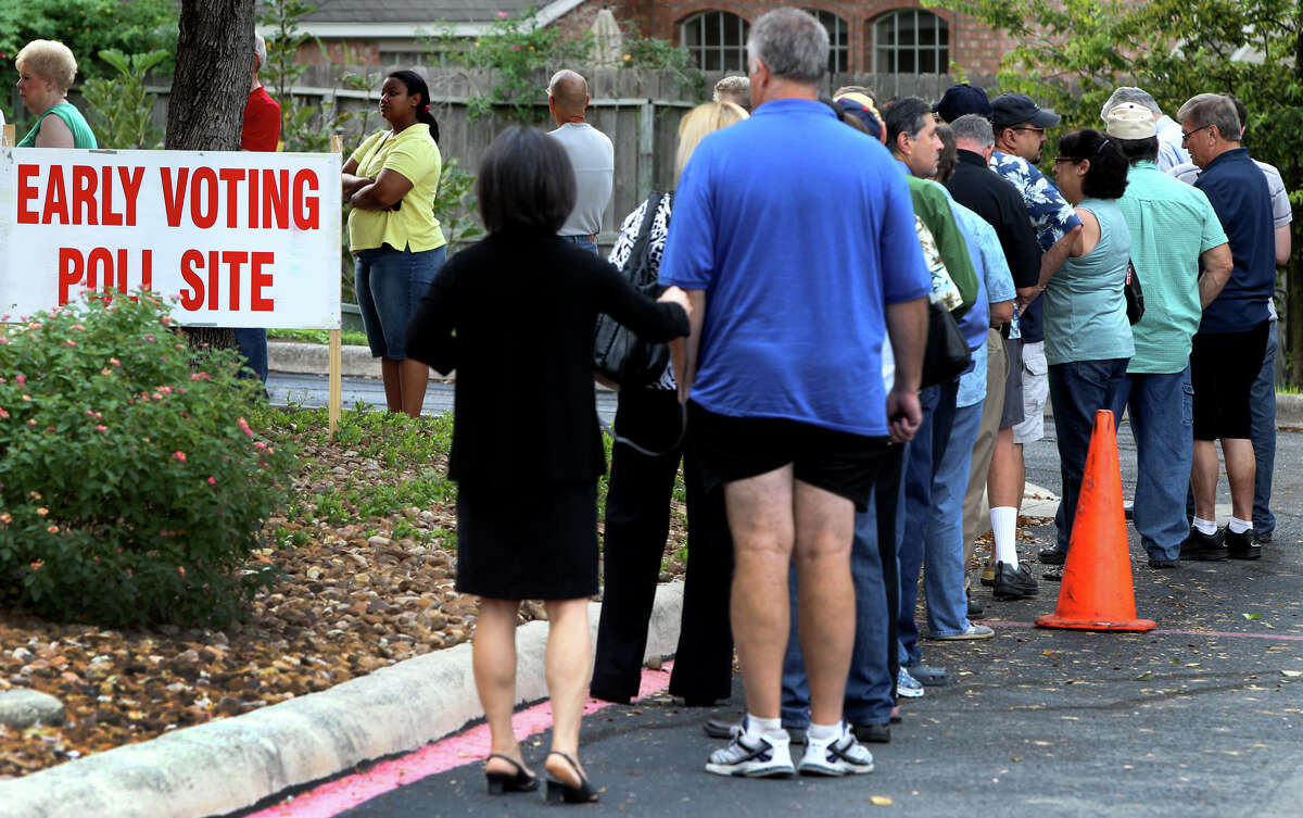 People line up for early voting Monday October 22, 2012 at the Brookhollow Public Library on Heimer road. Early voting ends November 2 and election day is November 6.