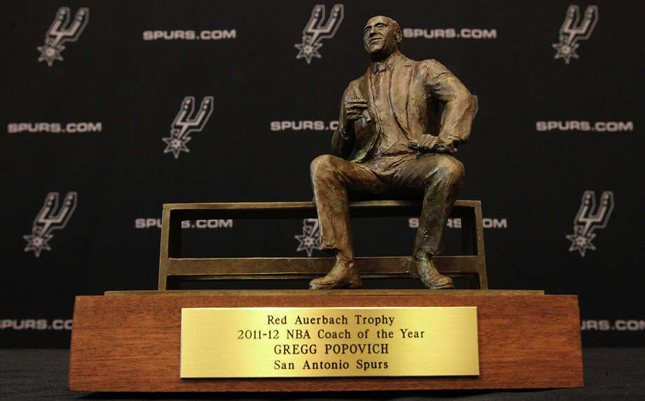 Spurs head coach Gregg Popovich receives the Red Auerbach trophy for being chosen as the 2011-12 NBA coach of the year on Tuesday, May 1, 2012. Popovich was joined by his staff along with Spurs General Manager R.C. Buford for the announcement at their training facility. Kin Man Hui/Express-News. Photo: KIN MAN HUI, SAN ANTONIO EXPRESS-NEWS / ©2012 San Antonio Express-News