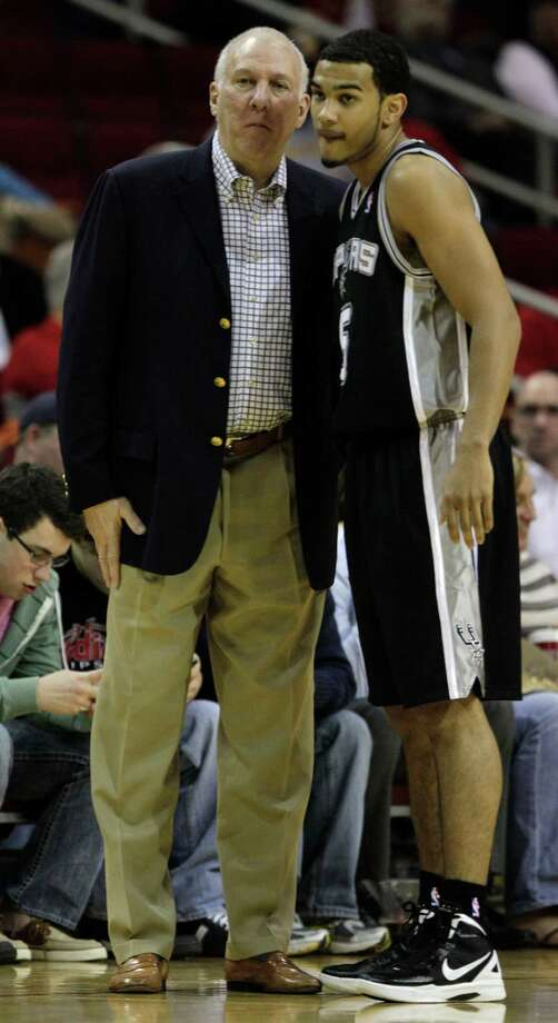 San Antonio Spurs head coach Gregg Popovich, left, talks to San Antonio Spurs guard Cory Joseph (5) during the first half of a pre-season NBA basketball game against the Houston Rockets at Toyota Center Saturday, Dec. 17, 2011, in Houston. ( Brett Coomer / Houston Chronicle ) Photo: Brett Coomer, Chronicle / © 2011 Houston Chronicle