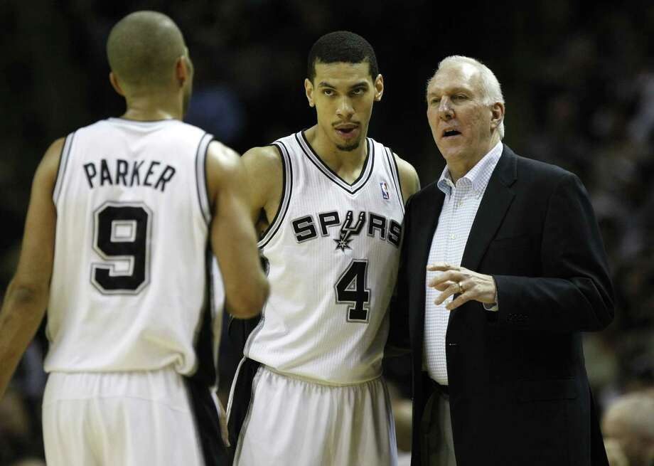 FOR SPORTS - San Antonio Spurs head coach Gregg Popovich talks with San Antonio Spurs guard Tony Parker (9) and San Antonio Spurs guard Danny Green (4) during first half action Thursday Jan. 5, 2012 at the AT&T Center.  (PHOTO BY KEVIN MARTIN/kmartin@express-news.net) Photo: KEVIN MARTIN, SAN ANTONIO EXPRESS-NEWS / SAN ANTONIO EXPRESS-NEWS (NFS)