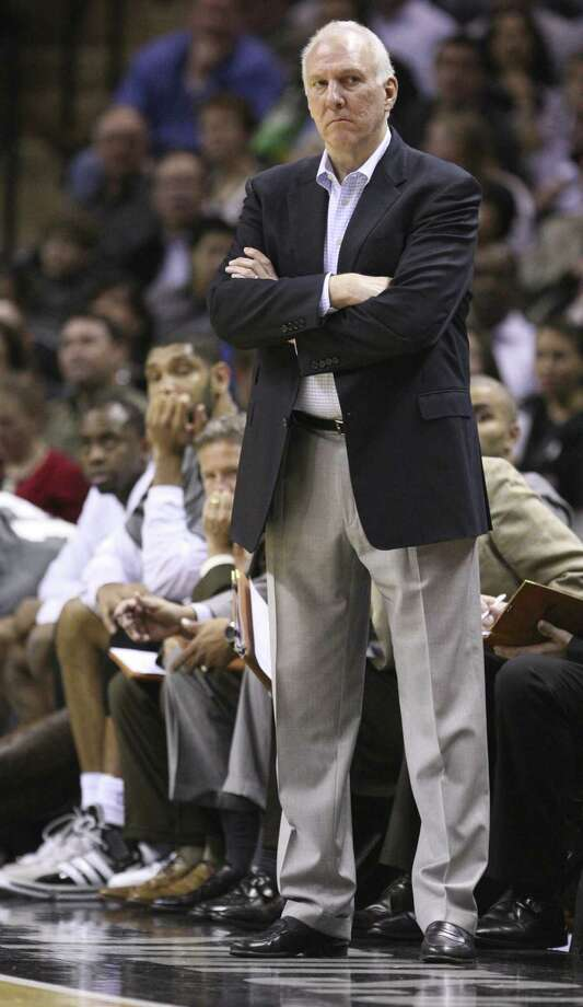 FOR SPORTS - San Antonio Spurs head coach Gregg Popovich looks on during second half action Thursday Jan. 5, 2012 at the AT&T Center.  (PHOTO BY EDWARD A. ORNELAS/eaornelas@express-news.net) Photo: EDWARD A. ORNELAS, SAN ANTONIO EXPRESS-NEWS / SAN ANTONIO EXPRESS-NEWS (NFS)