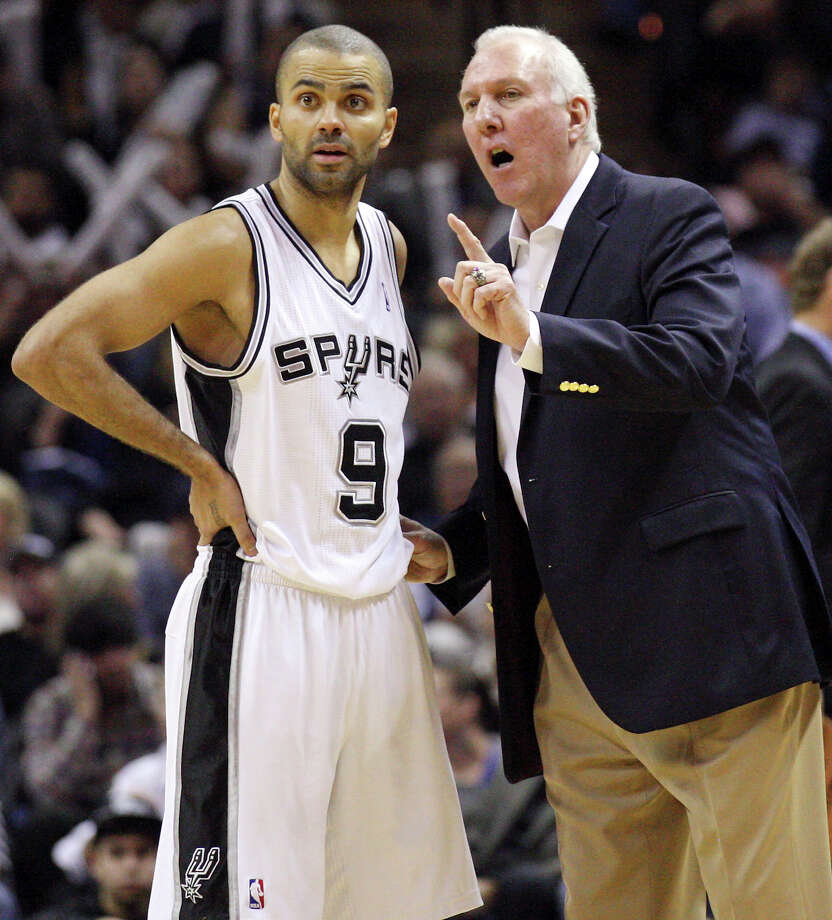 San Antonio Spurs' Tony Parker (left) talks with San Antonio Spurs' head coach Gregg Popovich during second half action against the Denver Nuggets Saturday Jan. 7, 2012 at the AT&T Center. The Spurs won 121-117.  (PHOTO BY EDWARD A. ORNELAS/eaornelas@express-news.net) Photo: EDWARD A. ORNELAS, SAN ANTONIO EXPRESS-NEWS / SAN ANTONIO EXPRESS-NEWS (NFS)