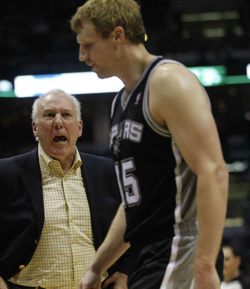 San Antonio Spurs head coach Gregg Popovich, left, yells at Matt Bonner (15) during a time out against the Milwaukee Bucks during the second half of an NBA basketball game, Tuesday, Jan. 10, 2012, in Milwaukee. The Bucks won 106-103.  (AP Photo/Jeffrey Phelps) Photo: Jeffrey Phelps, AP / FR59249 AP