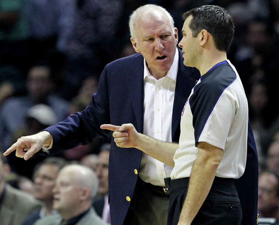 Gregg Popovich argues a call with the referee as the Spurs play Sacramento at the AT&T Center in San Antonio on January 20, 2012 Tom Reel/ San Antonio Express-News Photo: TOM REEL, SAN ANTONIO EXPRESS-NEWS / © 2012 San Antonio Express-News  MAGS OUT; TV OUT; NO SALES; SAN ANTONIO OUT; AP MEMBERS ONLY; MANDATORY CREDIT; EFE OUT