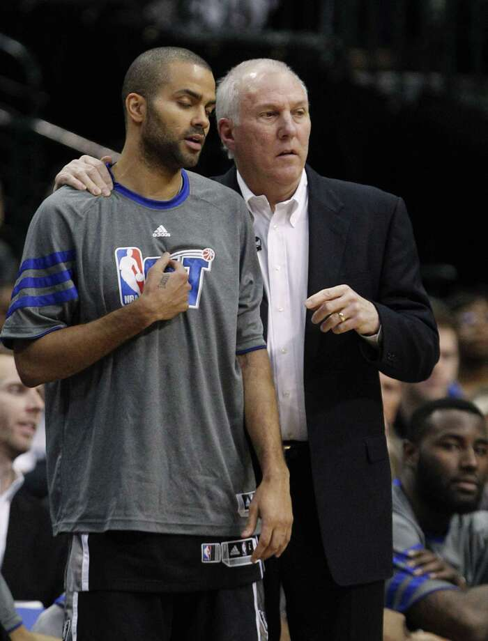 San Antonio Spurs point guard Tony Parker (9) closes his eyes and listens to coach Gregg Popovich during the second half of an NBA basketball game against the Dallas Mavericks in Dallas, Sunday, Jan. 29, 2012. The Mavericks won 101-100 in overtime. (AP Photo/LM  Otero) Photo: LM  Otero, AP / AP