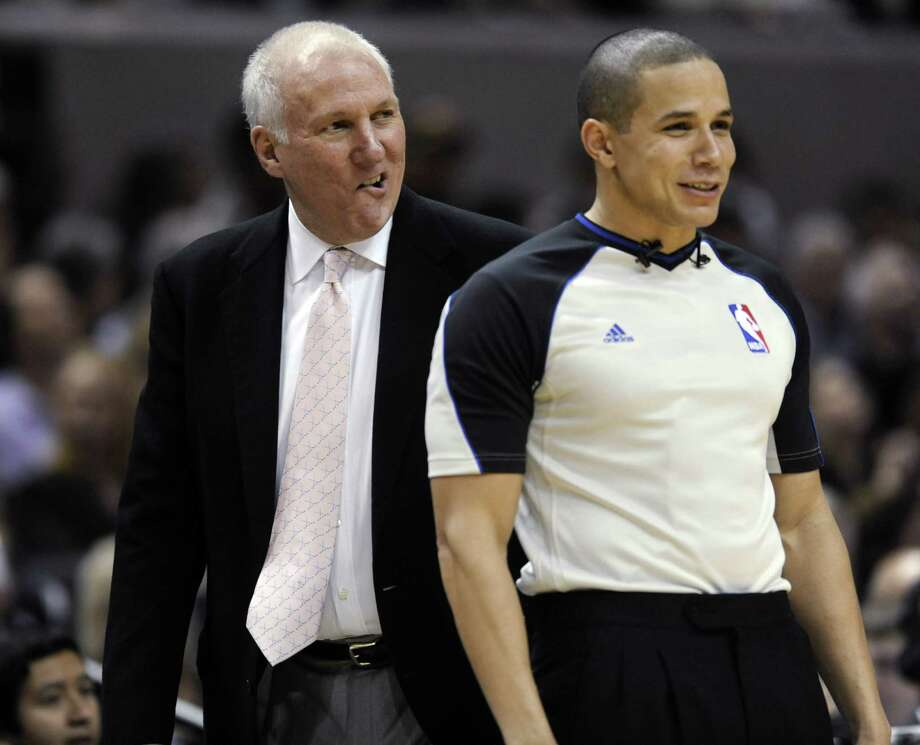 San Antonio Spurs coach Gregg Popovich questions a call with referee Steve Anderson during the second half of an NBA basketball game in San Antonio Thursday, Feb. 2, 2012. The Spurs defeated the New Orleans Hornets 93-81. (AP Photo/Bahram Mark Sobhani) Photo: Bahram Mark Sobhani, AP / FR91484 AP