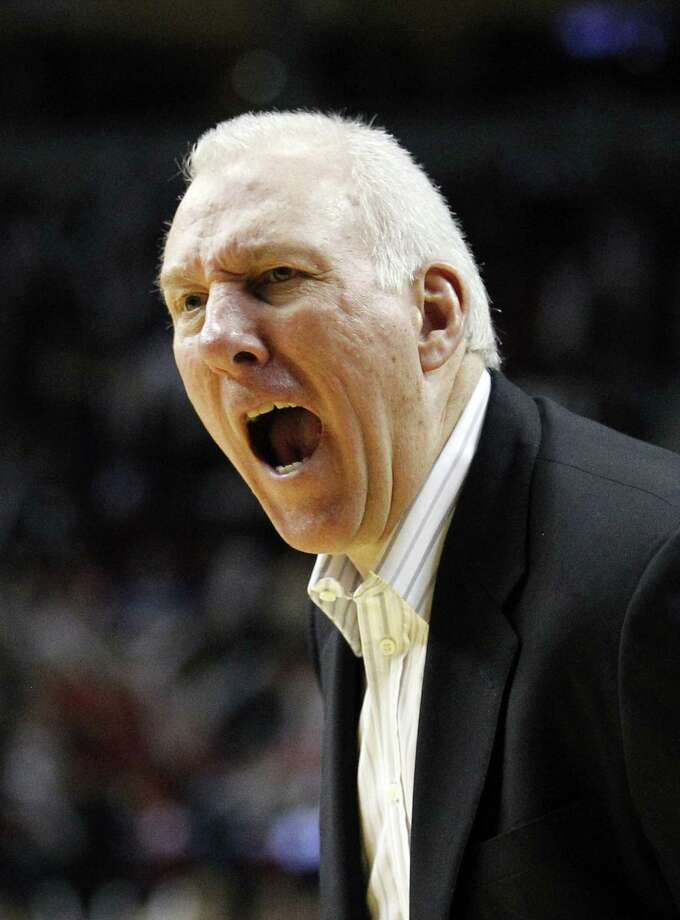 San Antonio Spurs head coach Gregg Popovich  shouts to his team in the fourth quarter during an NBA basketball game with the Portland Trail Blazers Tuesday, Feb. 21, 2012, in Portland, Ore. The Trail Blazers defeated the Spurs 137-97. (AP Photo/Rick Bowmer) Photo: Rick Bowmer, AP / AP