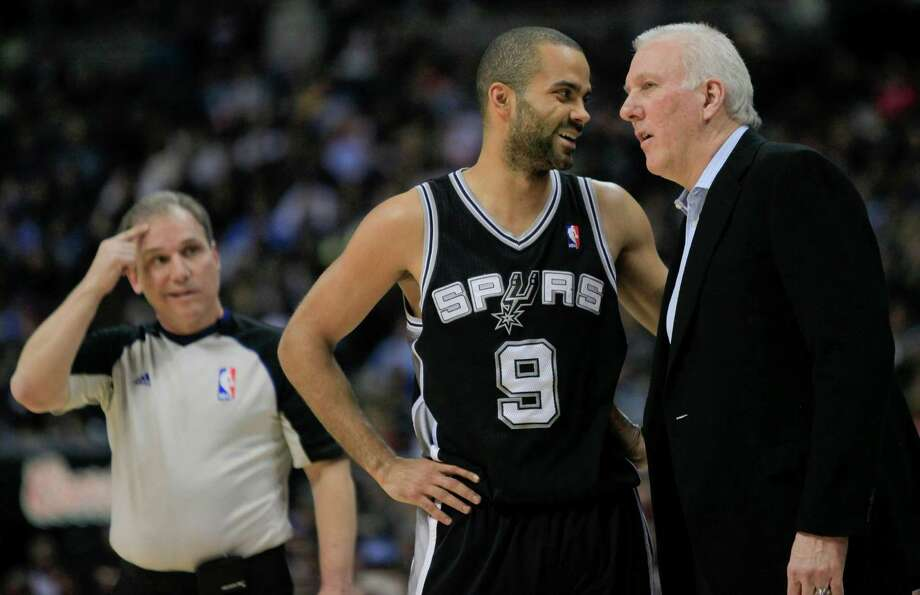 San Antonio Spurs point guard Tony Parker (9) and head coach Gregg Popovich, right, talk on the sideline during the second quarter of an NBA basketball game against the Denver Nuggets, Thursday, Feb. 23, 2012, in Denver. (AP Photo/Barry Gutierrez) Photo: Barry Gutierrez, AP / FR170088 AP