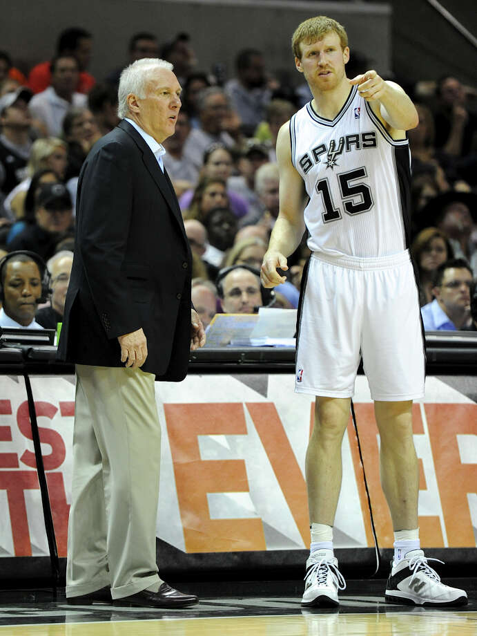 San Antonio Spurs head coach Gregg Popovich talks with San Antonio Spurs power forward Matt Bonner (15) during a NBA basketball game between the Philadelphia 76ers and the San Antonio Spurs at the AT&T Center in San Antonio, Texas on March 25, 2012.John Albright / Special to the Express-News. Photo: JOHN ALBRIGHT, SPECIAL TO THE EXPRESS-NEWS / San Antonio Express-News