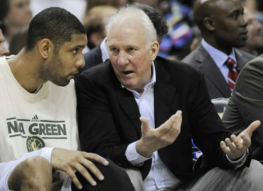 San Antonio Spurs head coach Gregg Popovich, right, talks to  Tim Duncan during the second half of an NBA basketball game against the New Orleans Hornets, Friday, April 6, 2012, in San Antonio. San Antonio won 128-103. (AP Photo/Darren Abate) Photo: Darren Abate, AP / FR115 AP