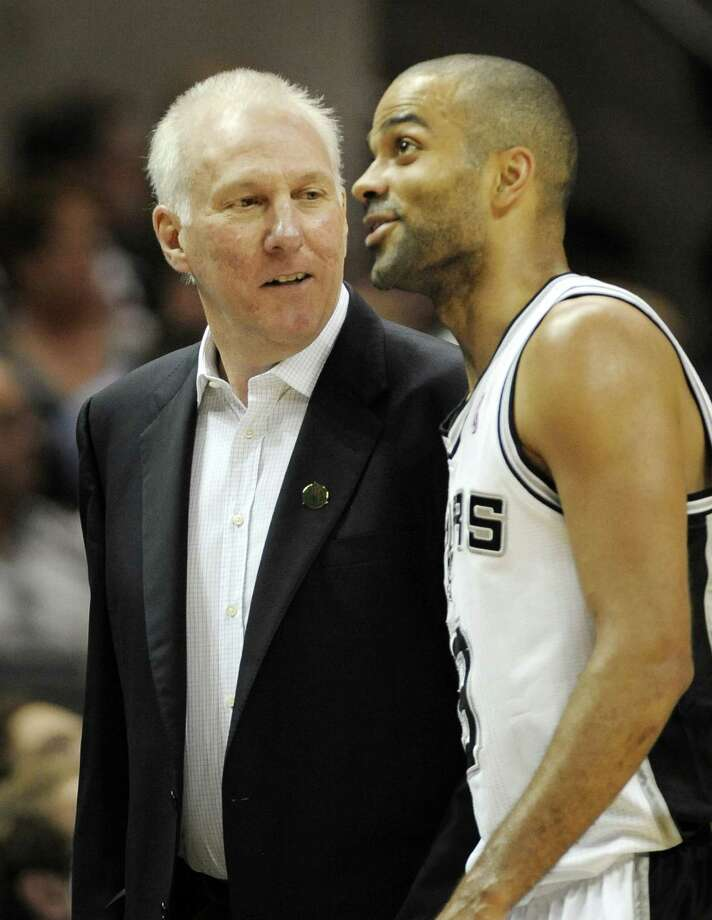 San Antonio Spurs head coach Gregg Popovich, left, talks to Spurs' Tony Parker, of France, during the first half of an NBA basketball game against the Utah Jazz, Sunday, April 8, 2012, in San Antonio. (AP Photo/Darren Abate) Photo: Darren Abate, AP / FR115 AP