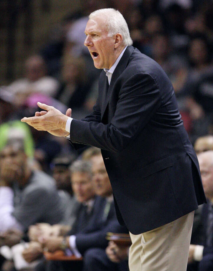 FOR SPORTS - San Antonio Spurs head coach Gregg Popovich yells instructions to the team against the Cleveland Cavaliers during second half action Sunday April 22, 2012 at the AT&T Center. The Spurs won 114-98. (PHOTO BY EDWARD A. ORNELAS/SAN ANTONIO EXPRESS-NEWS) Photo: EDWARD A. ORNELAS, SAN ANTONIO EXPRESS-NEWS / © SAN ANTONIO EXPRESS-NEWS (NFS)