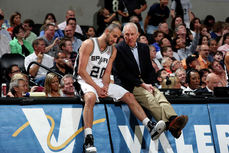 San Antonio Spurs Head Coach Gregg Popovich talks with Manu Ginobili during a break in their game against the Portland Trail Blazer at the AT&T Center, Monday, April 23, 2012. Jerry Lara/San Antonio Express-News Photo: Jerry Lara, San Antonio Express-News / © San Antonio Express-News
