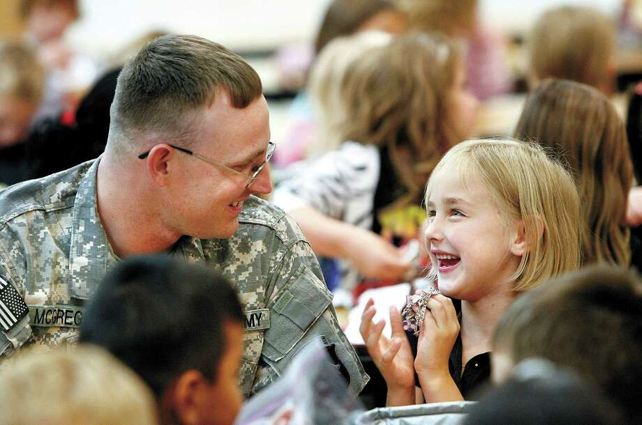 Colleges and universities are training a generation of professionals to understand military family culture. Photo: Courtesy, Associated Press / THE WINCHESTER STAR