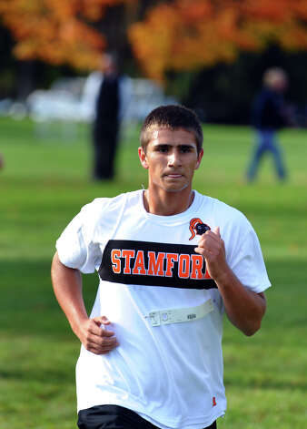 Stamford's Lyubo Hadzhiev takes part in boys FCIAC cross country action at Wavenly Park in New Canaan, Conn. on Thursday October 18, 2012. Photo: Christian Abraham / Connecticut Post