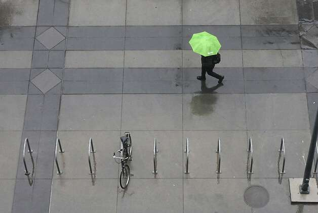 Umbrellas were called for as rain blanketed Sacramento, Calif, Monday, Oct. 22, 2012.  The first storm of the season swept through Northern California bringing rain to the lower elevations and snow in the mountains. Photo: Rich Pedroncelli, Associated Press