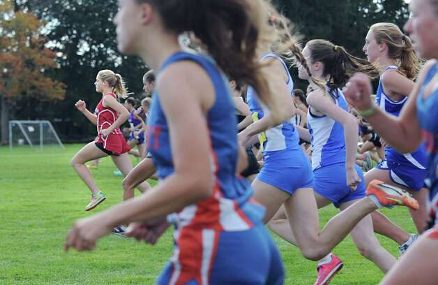 The start of the FCIAC girls high school cross country championship at Waveny Park in New Canaan, Thursday afternoon, Oct. 18, 2012. At left is Jenny Goggin of Greenwich High School. Photo: Bob Luckey / Greenwich Time