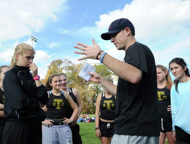 Trumbull High School Girls Cross Country Coach Jim McCaffrey speaks with his team during the FCIAC girls high school cross country championship at Waveny Park in New Canaan, Thursday afternoon, Oct. 18, 2012. Photo: Bob Luckey / Greenwich Time