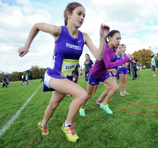 At left, Claire Howlett of Westhill High School and teammates warm-up prior to the start of the FCIAC girls high school cross country championship at Waveny Park in New Canaan, Thursday afternoon, Oct. 18, 2012. Photo: Bob Luckey / Greenwich Time