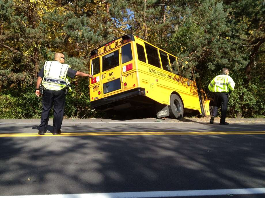 A North Colonie school bus slid off Maxwell Road in Colonie on Oct. 23, 2012. (Will Waldron/Times Union) Photo: Will Waldron Times Union