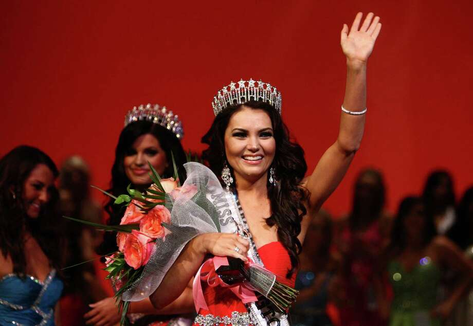 Newly crowned Miss Washington USA Cassandra Searles waves to the crowd during the Miss Washington USA and Miss Teen Washington USA pageant on Sunday, Oct. 21, 2012, at the Highline Performing Arts Center in Burien. Searles was Miss Redmond USA. Miss Washington USA was chosen at the event to represent the Evergreen State in the 2013 Miss USA pageant. Photo: JOSHUA TRUJILLO / SEATTLEPI.COM