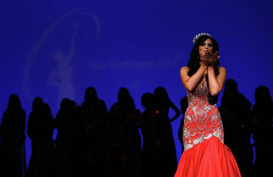 Former Miss Washington USA Christina Clarke blows a kiss to the audience during the Miss Washington USA and Miss Teen Washington USA pageant on Sunday at the Highline Performing Arts Center in Burien. Miss Washington was chosen at the event to represent the Evergreen State in the 2013 Miss USA pageant. Photo: JOSHUA TRUJILLO / SEATTLEPI.COM