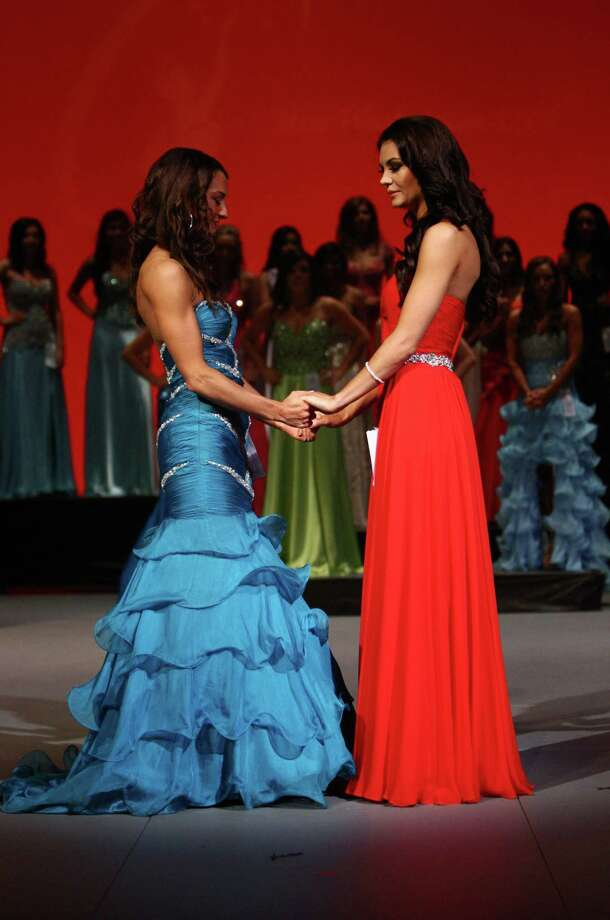 Miss Eastside USA Whitney Young, left, and Miss Redmond USA Cassandra Searles listen as the winner is announced between the two finalists during the Miss Washington USA and Miss Teen Washington USA pageant on Sunday at the Highline Performing Arts Center in Burien. Miss Washington was chosen at the event to represent the Evergreen State in the 2013 Miss USA pageant. Photo: JOSHUA TRUJILLO / SEATTLEPI.COM