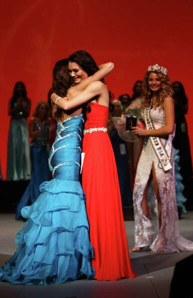 Miss Eastside USA Whitney Young, left, is embraced by Miss Redmond USA Cassandra Searles as Searles
