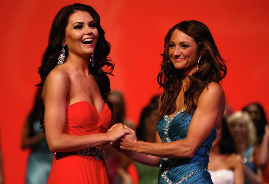 Miss Redmond USA Cassandra Searles, left, and Miss Eastside USA Whitney Young are announced as finalists during the Miss Washington USA and Miss Teen Washington USA pageant on Sunday at the Highline Performing Arts Center in Burien. Miss Washington was chosen at the event to represent the Evergreen State in the 2013 Miss USA pageant. Photo: JOSHUA TRUJILLO / SEATTLEPI.COM