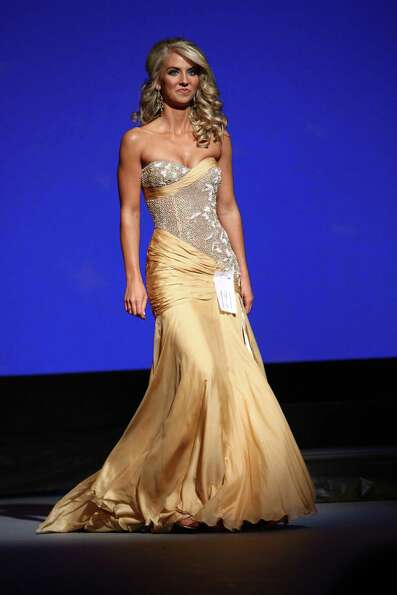 Miss Three Rivers USA Deidra Stands participates in the evening gown competition during the Miss Was