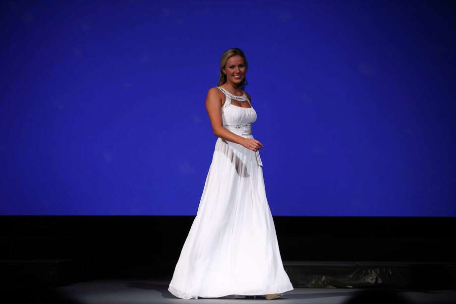 Miss King County Teen USA Hadyn Daugs participates in the evening gown competition during the Miss Washington USA and Miss Teen Washington USA pageant on Sunday at the Highline Performing Arts Center in Burien. Miss Washington was chosen at the event to represent the Evergreen State in the 2013 Miss USA pageant. Photo: JOSHUA TRUJILLO / SEATTLEPI.COM