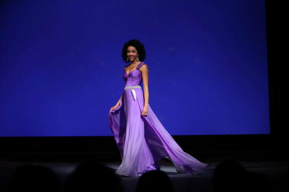 Miss Tri-Cities Teen USA Maeloni Ogle participates in the evening gown competition during the Miss Washington USA and Miss Teen Washington USA pageant on Sunday at the Highline Performing Arts Center in Burien. Miss Washington was chosen at the event to represent the Evergreen State in the 2013 Miss USA pageant. Photo: JOSHUA TRUJILLO / SEATTLEPI.COM