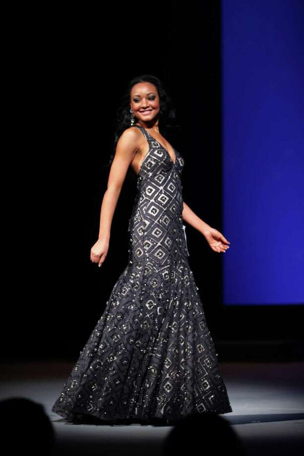 Miss Renton USA Britni Griffin participates in the evening gown competition during the Miss Washington USA and Miss Teen Washington USA pageant on Sunday at the Highline Performing Arts Center in Burien. Miss Washington was chosen at the event to represent the Evergreen State in the 2013 Miss USA pageant. Photo: JOSHUA TRUJILLO / SEATTLEPI.COM