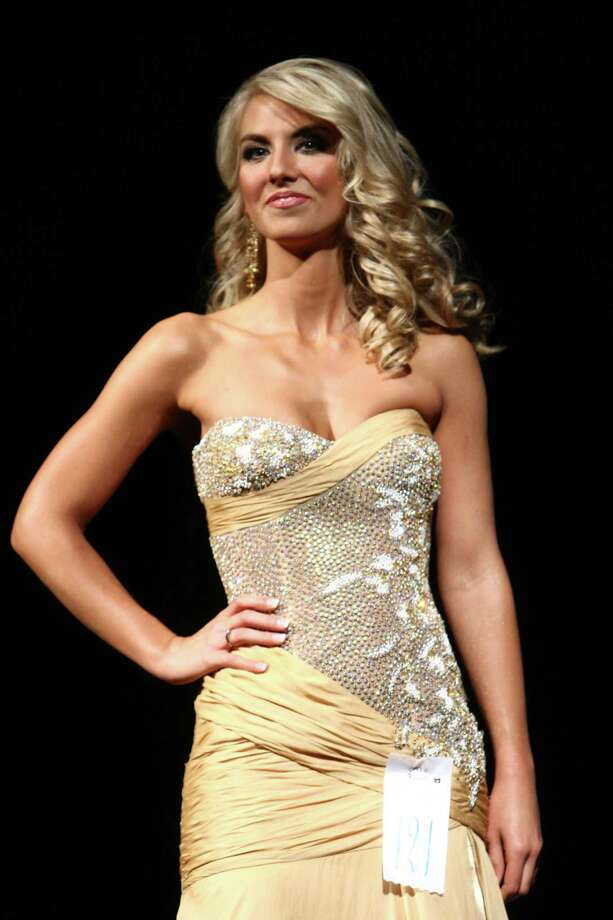 Miss Three Rivers USA Deidra Stands participates in the evening gown competition during the Miss Washington USA and Miss Teen Washington USA pageant on Sunday at the Highline Performing Arts Center in Burien. Miss Washington was chosen at the event to represent the Evergreen State in the 2013 Miss USA pageant. Photo: JOSHUA TRUJILLO / SEATTLEPI.COM