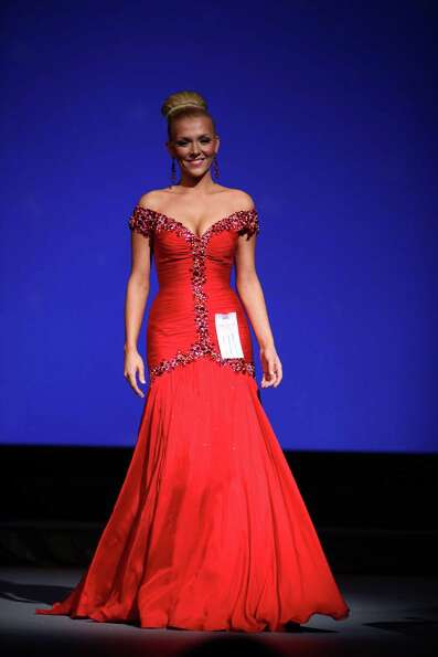 Miss Red Mountain USA Cheyenne Van Tine participates in the evening gown competition during the Miss