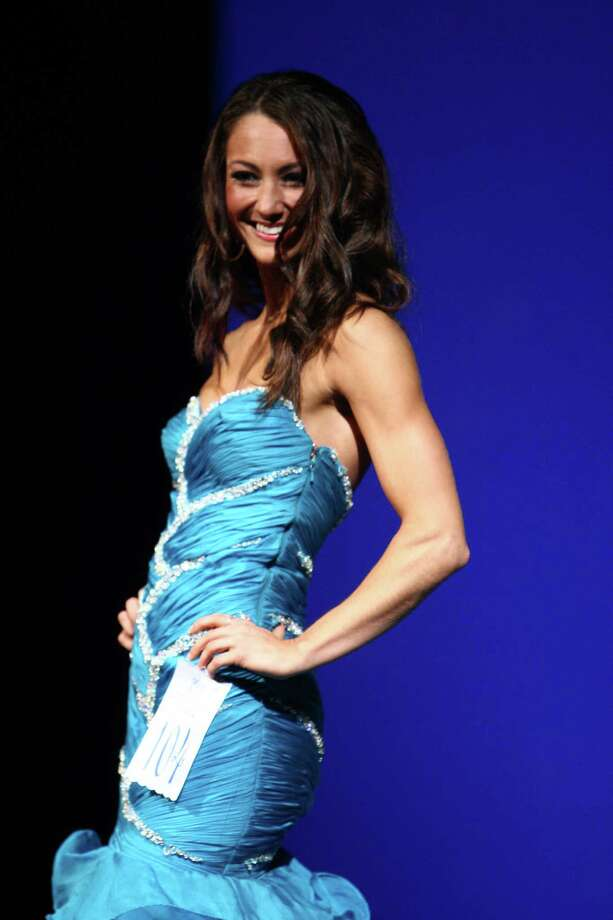 Miss Eastside USA Whitney Young participates in the evening gown competition during the Miss Washington USA and Miss Teen Washington USA pageant on Sunday at the Highline Performing Arts Center in Burien. Miss Washington was chosen at the event to represent the Evergreen State in the 2013 Miss USA pageant. Photo: JOSHUA TRUJILLO / SEATTLEPI.COM