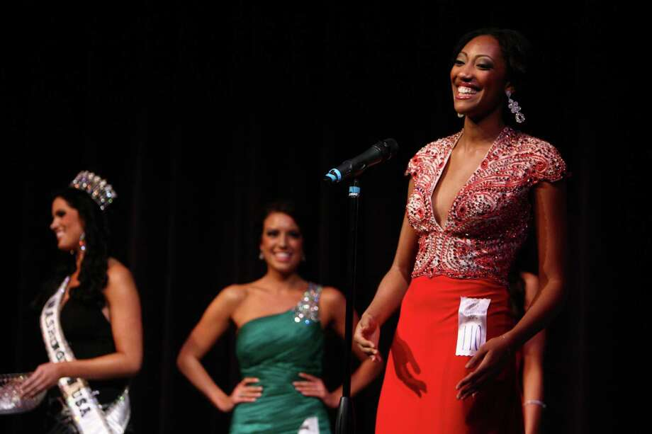 Miss New Castle USA Domonique Price answers a question during the Miss Washington USA and Miss Teen Washington USA pageant on Sunday at the Highline Performing Arts Center in Burien. Miss Washington was chosen at the event to represent the Evergreen State in the 2013 Miss USA pageant. Photo: JOSHUA TRUJILLO / SEATTLEPI.COM